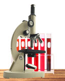 Laboratory metal microscope and test tubes with blood in holder Stock Images
