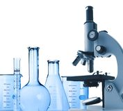 Laboratory metal microscope and test-tubes isolated on white Stock Photos