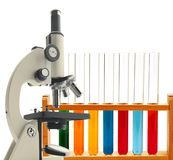 Laboratory metal microscope and test tubes with liquid isolated Stock Photo