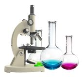Laboratory metal microscope and test tubes with liquid isolated Royalty Free Stock Photos