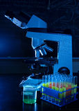 Laboratory microscope with test tubes. On table Royalty Free Stock Photos