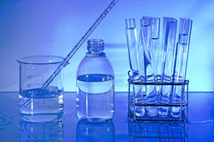 Laboratory Requirements. Blue. Laboratory glass. Backlight on blue background Royalty Free Stock Images