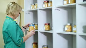 Laboratory research of corn seeds. samples of different species, varieties of selection corn. laboratory for the stock video footage