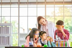 In laboratory room, boy look through microscope royalty free stock images