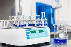 Shaker loaded with erlenmeyers and beakers. Laboratory shaker loaded with erlenmeyers and beakers Stock Photography