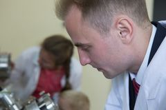 Laboratory specialist examines the data obtained on a special apparatus for analyzing samples royalty free stock photos