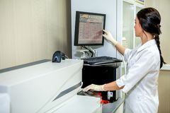 Laboratory Specialist Introduces Settings for Blood Testing Apparatus stock photos