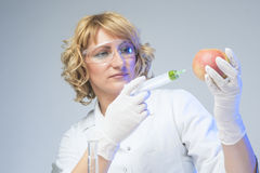 Laboratory Staff Testing Apple Using Syringe Stock Images