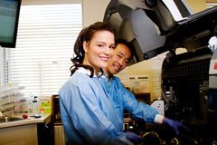 Laboratory staff trouble shooting chemistry analyzer Stock Image