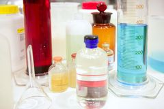 Laboratory stuff, glass cylinder, colorful liquids Royalty Free Stock Photography
