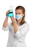 Laboratory Technician. Female laboratory technician examining flask isolated over white background Royalty Free Stock Images