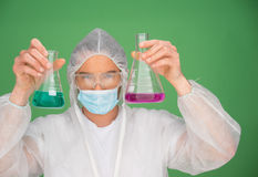 Laboratory technician holding up chemicals Royalty Free Stock Images