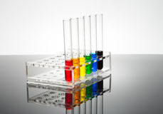 Laboratory test tubes. On a black gloss Royalty Free Stock Photos