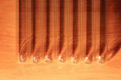 Laboratory Test Tubes, Vials, on wood background Stock Photos