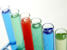 Laboratory vials. Filled with colorful liquids shot on white background Royalty Free Stock Photos