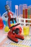 Laboratory ware and microscope Royalty Free Stock Photo
