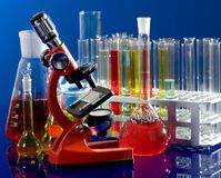 Laboratory ware and microscope Royalty Free Stock Photo