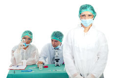 Laboratory woman with team Royalty Free Stock Images