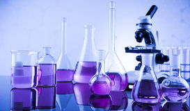 Laboratory work place with microscope and glassware Royalty Free Stock Photos