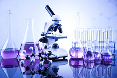 Laboratory work place with microscope and glassware Royalty Free Stock Photography