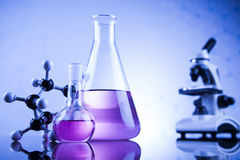 Laboratory work place with microscope and glassware Stock Photo