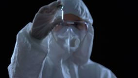 Laboratory worker showing bottle with white powder, illegal drug production. Stock footage stock video