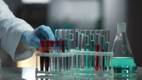 Laboratory working surface occupied by test tubes and flasks, research process. Stock footage stock video
