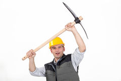Laborer carrying pickaxe Royalty Free Stock Photography