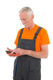 Laborer with digital tablet Royalty Free Stock Image