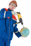 Laborer with hand drill and globe Royalty Free Stock Photography