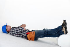 Laborer laid on the floor Royalty Free Stock Image