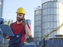 Laborer outside a factory Royalty Free Stock Photography
