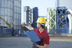 Laborer outside a factory Stock Photography