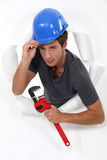 Laborer passing through wall Stock Photography