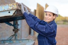 Laborer posing and smiling. Yard Royalty Free Stock Photography