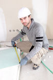 Laborer in room under construction Stock Photos