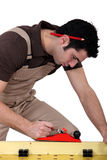 Laborer sawing Royalty Free Stock Photos