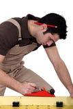 Laborer sawing Royalty Free Stock Photos