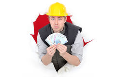 Laborer showing his money Stock Photo
