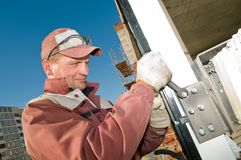 Laborer and spanner wrench Royalty Free Stock Photo