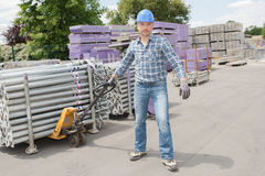 Laborer using pull cart. Laborer using a pull cart Royalty Free Stock Image