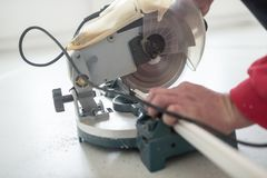 Laborer using a small electric circular saw Royalty Free Stock Photos