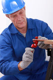 Laborer working. On a copper pipe Stock Images