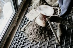 Laborer working on a floor screed with underfloor heating. System royalty free stock image