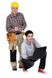 Laborer and young student Stock Images