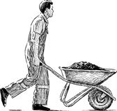 Laborer z wheelbarrow Zdjęcia Stock