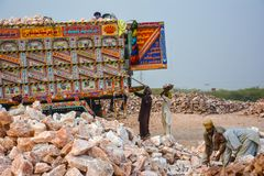 Laborers loading chunks of rock salt into a truck. Natural lamps are famous all over the world for their unique beautiful light. These salt lamps emit stock images
