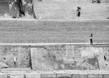 Laborers, moving rocks, Rishikesh, India. Workers move rocks and stone on the banks of the ganges, Rishikesh, India royalty free stock image