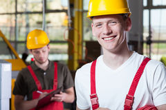 Laborers in overalls and hardhat. Young laborers in overalls and hardhat, horizontal Royalty Free Stock Photos