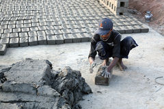 Laborers prepare bricks at a brick kiln in Sarberia, West Bengal, India. The Indian brick industry is the second largest in the world after China royalty free stock images